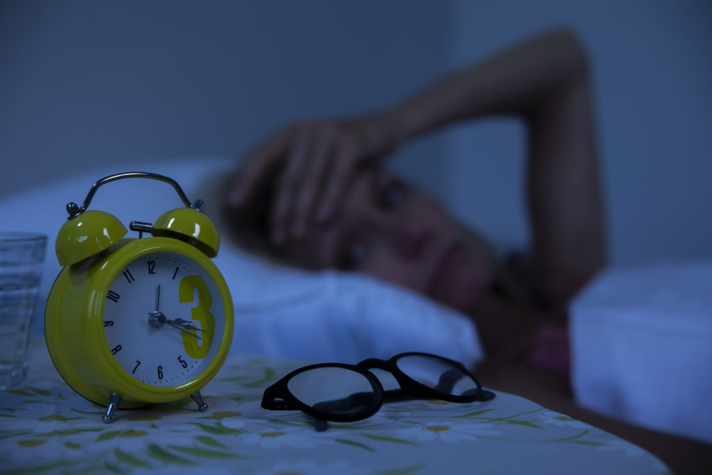 Woman struggling to wake up in the morning.